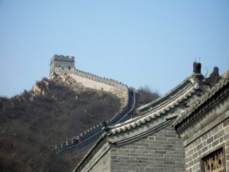 The Great Wall of China winding its way up a hill